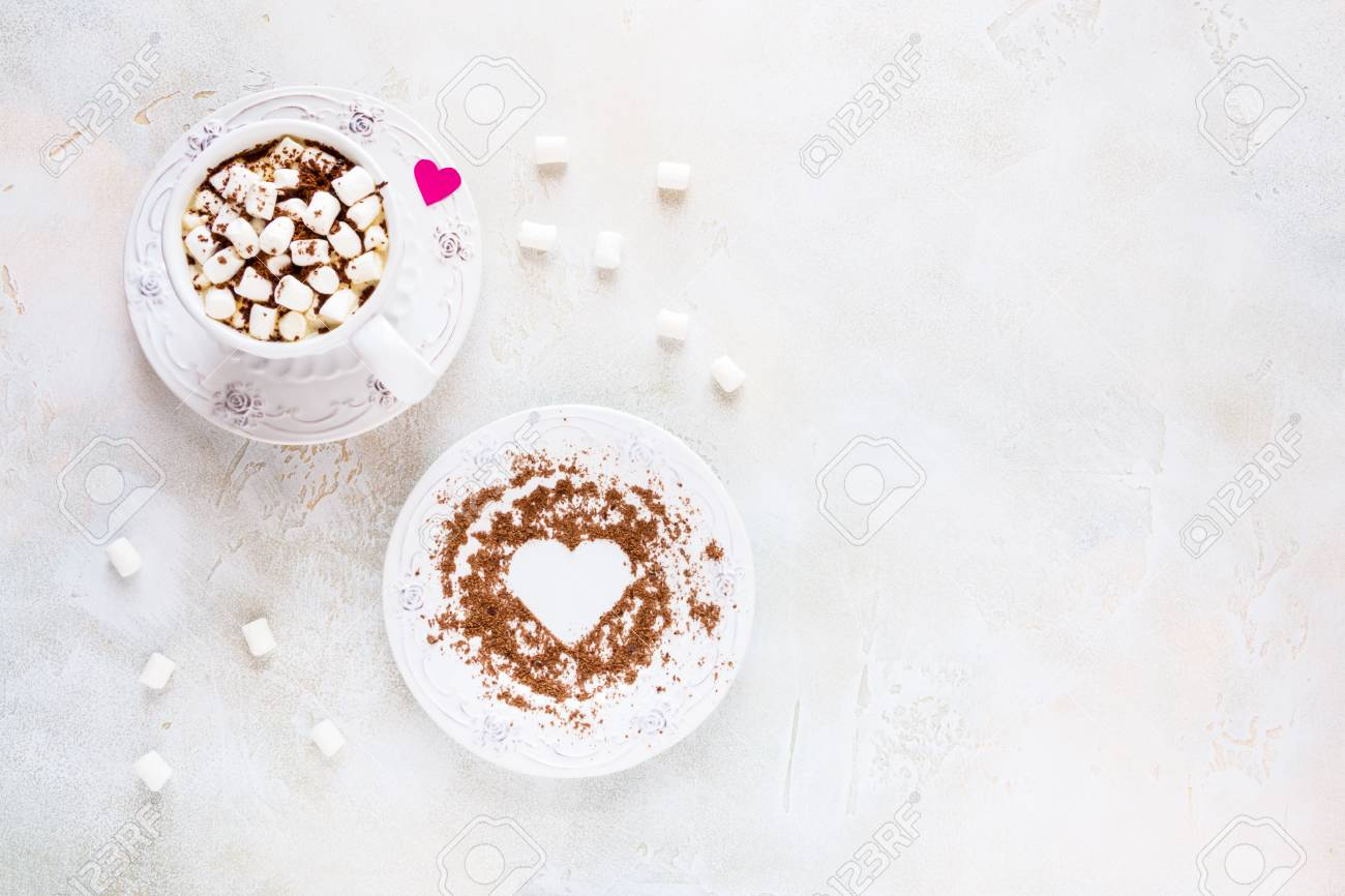 Valentine day decoration, breakfast, white vintage cup and plate, coffee with small marshmallows and hearts made from red paper and grated chocolate. Top view, flat lay. - 70721622