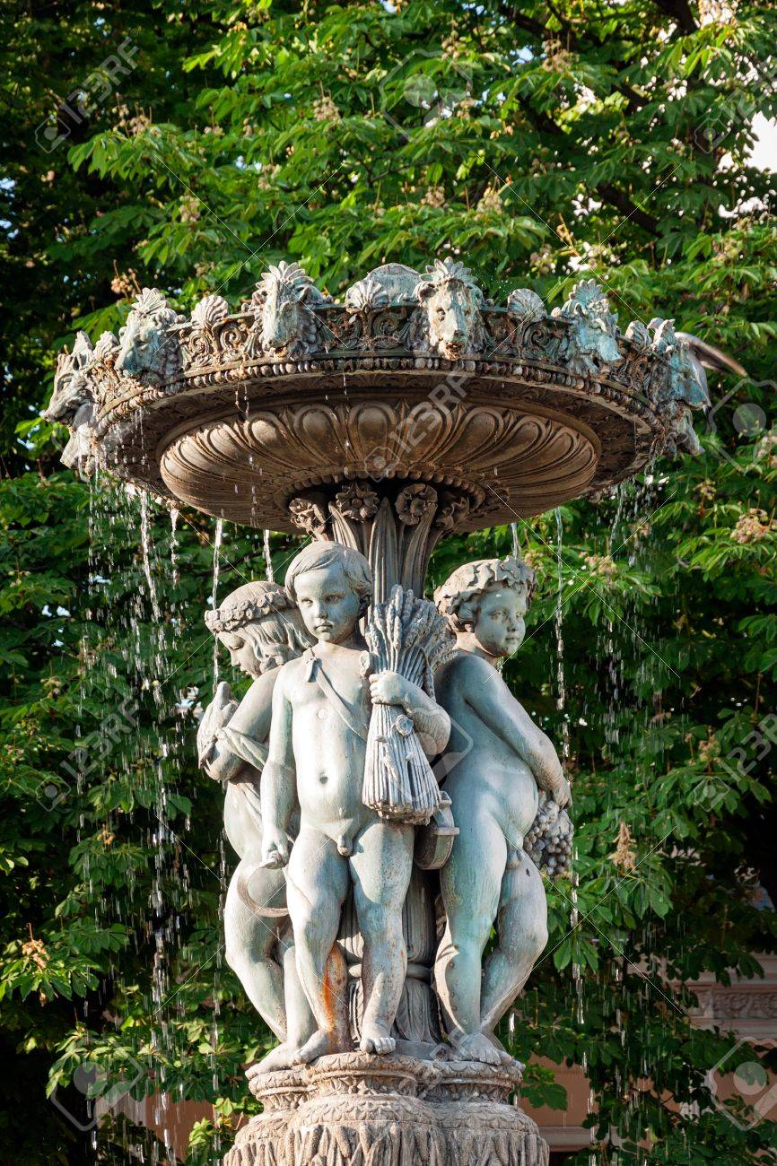garden water fountain with statues of little boys paris france