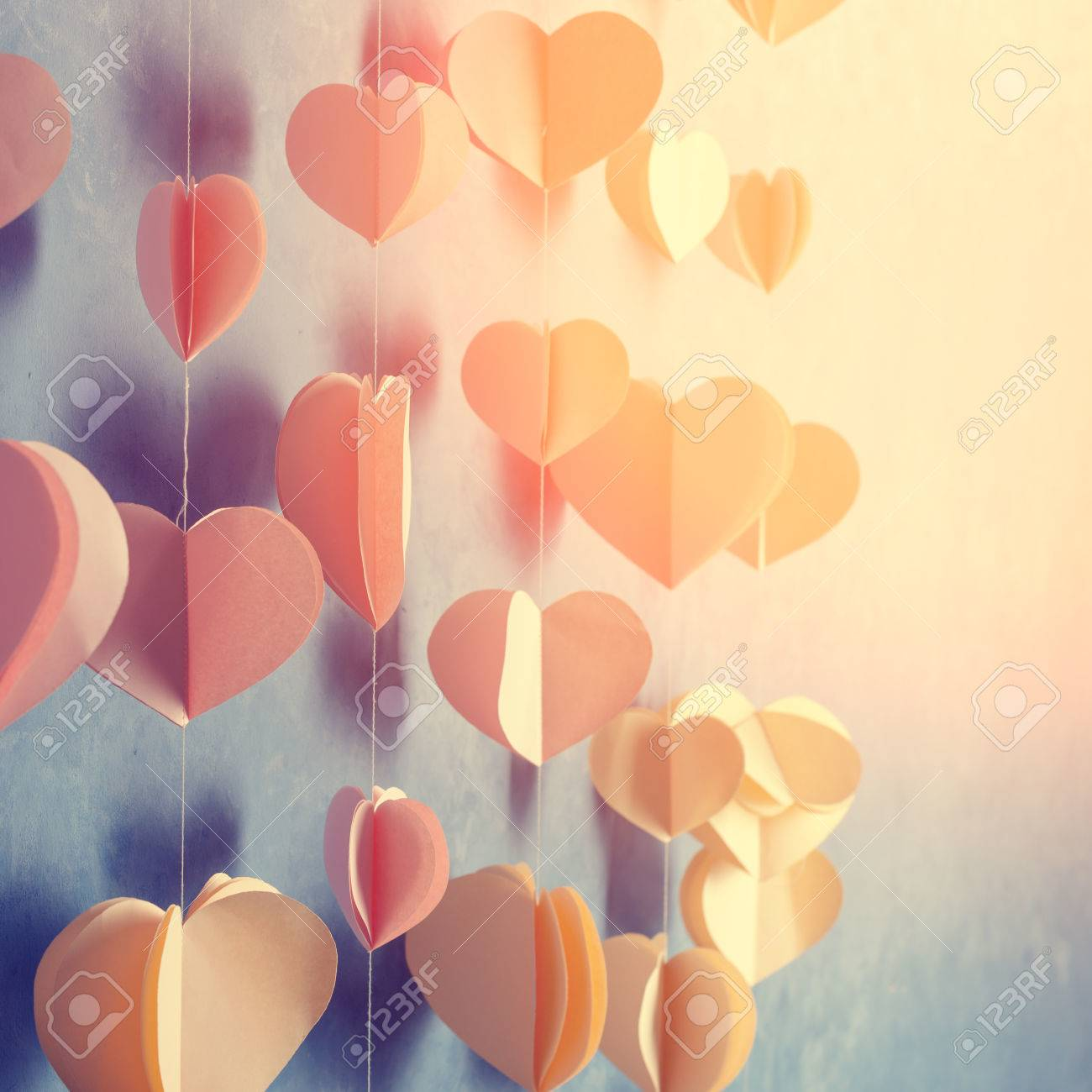 Colorful Hearts Paper Garland Hanging On The Wall. Romantic ...
