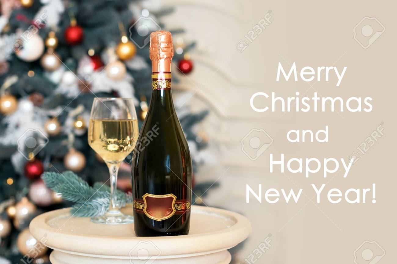 happy new year card with white wine or champagne in christmas setting winter holidays theme