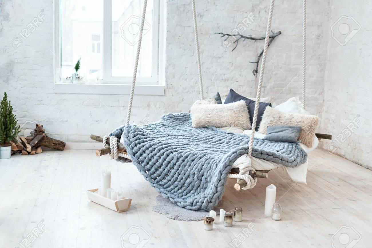 123RF.com & White loft interior in classic scandinavian style. Hanging bed..
