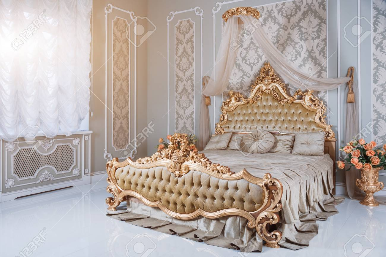 Luxury Bedroom In Light Colors With Golden Furniture Details Stock Photo Picture And Royalty Free Image Image 76951389