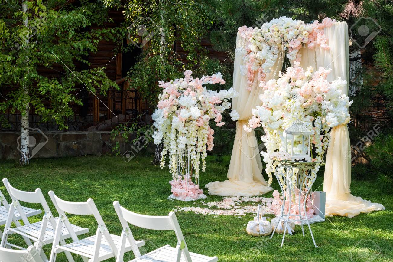 Wedding Arch Decorated With Cloth And Flowers Outdoors. Beautiful ...