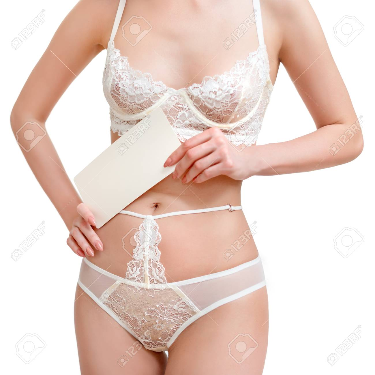 92b94cdea63 Slim, beautiful woman in lace lingerie holding blank sheet of paper. Body  parts, closeup of women half length body in white strings and bra.
