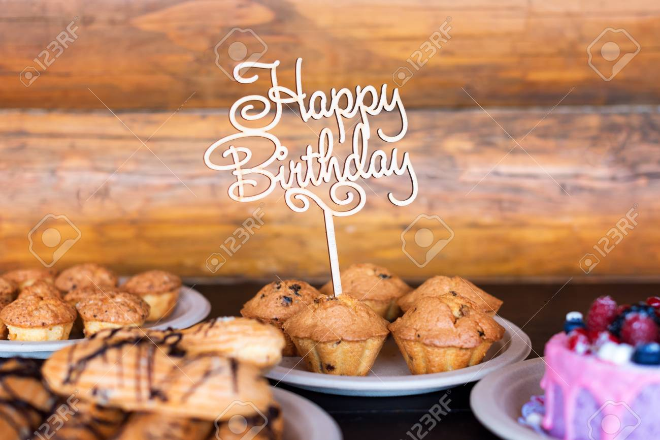 Awe Inspiring Birthday Cake And Muffins With Wooden Greeting Sign On Rustic Funny Birthday Cards Online Eattedamsfinfo