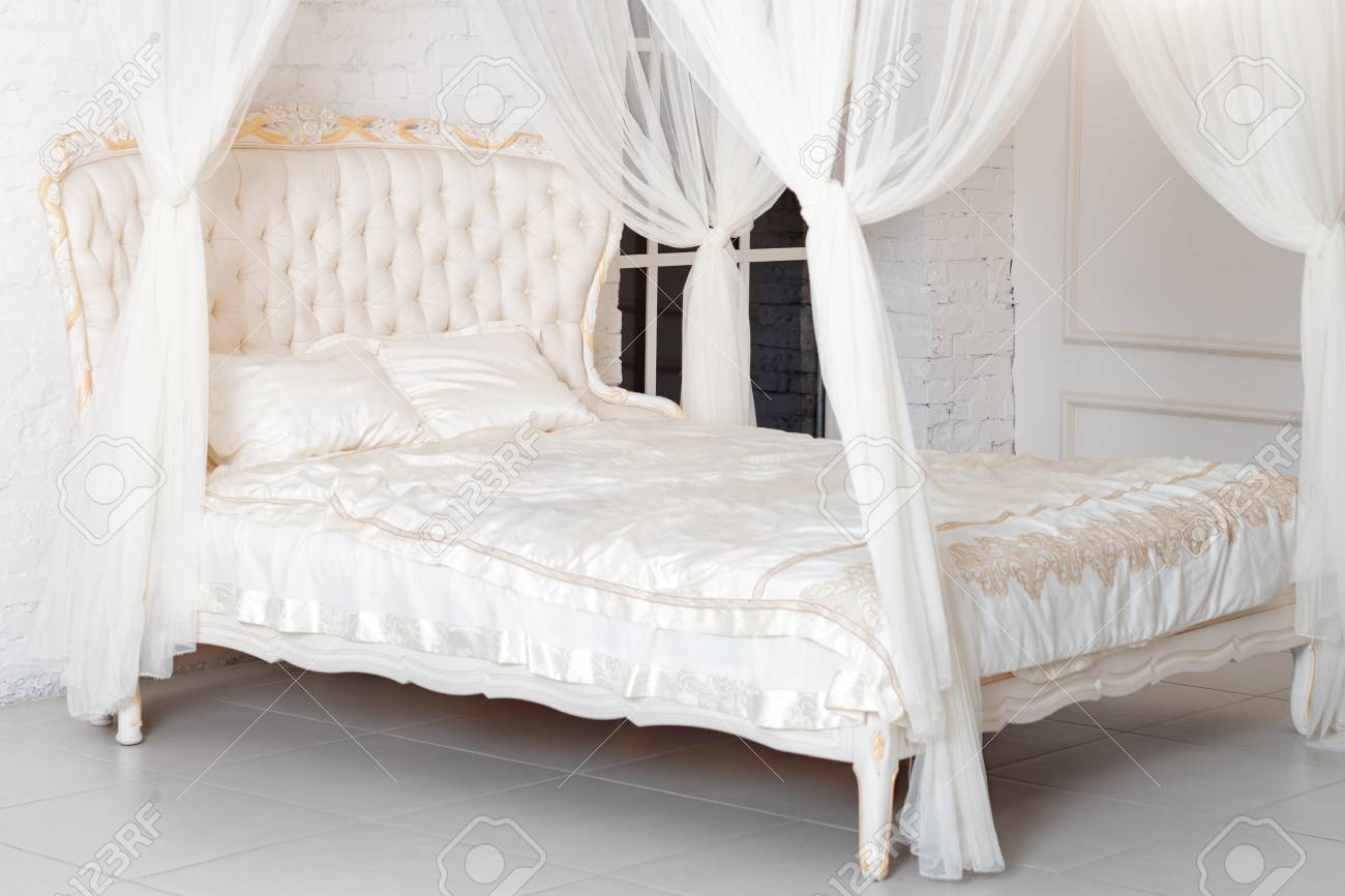 Picture of: Bedroom In Soft Light Colors Big Comfortable Four Poster Double Stock Photo Picture And Royalty Free Image Image 91242171