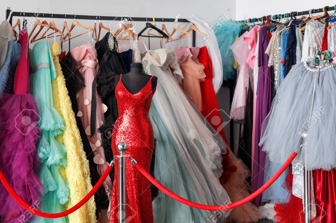 Many Ladies Evening Gown Long Dresses On Hanger In The Dress.. Stock ...