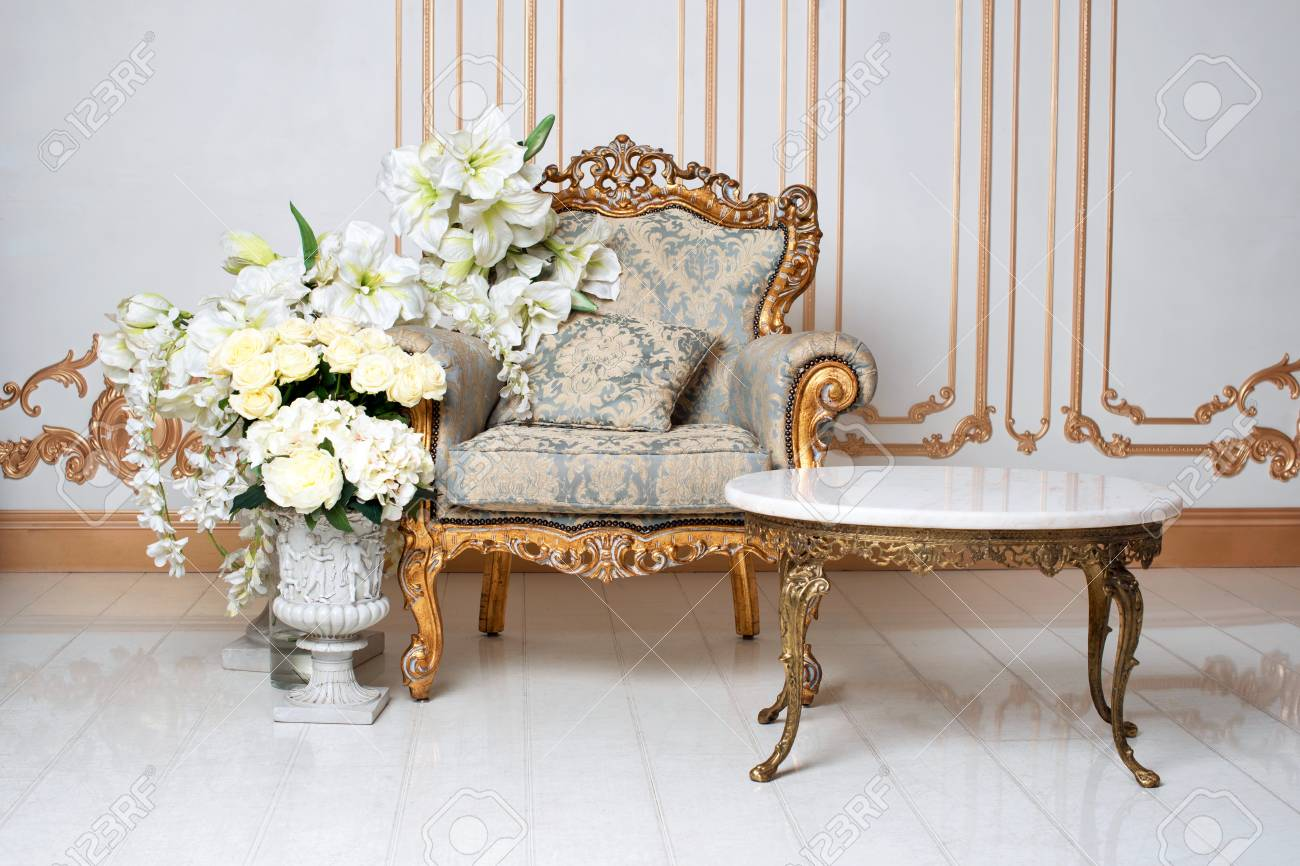 Luxurious vintage interior in the aristocratic style with elegant armchair and flowers. Retro, classics - 92411303