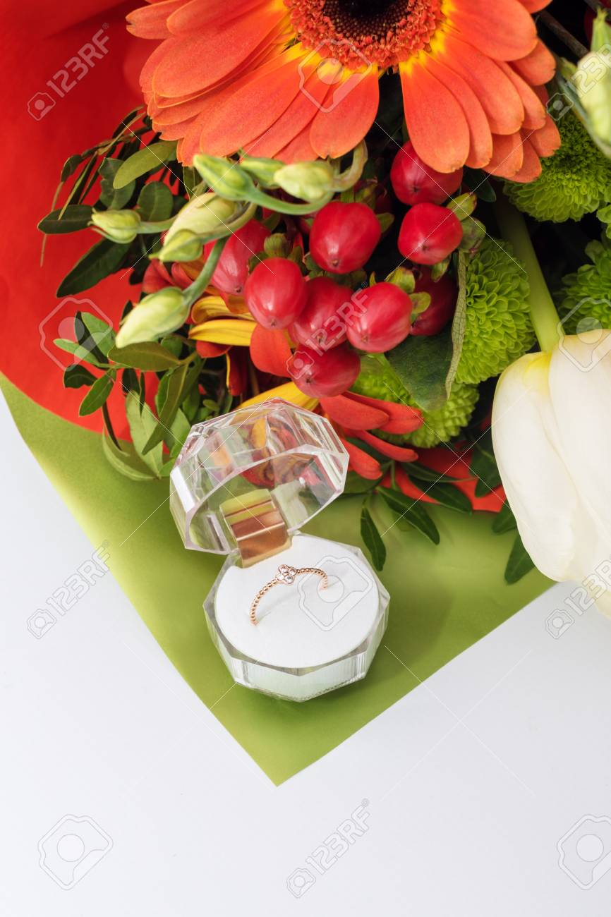 Engagement Ring In A Gift Box With Bright Bouquet Of Flowers ...