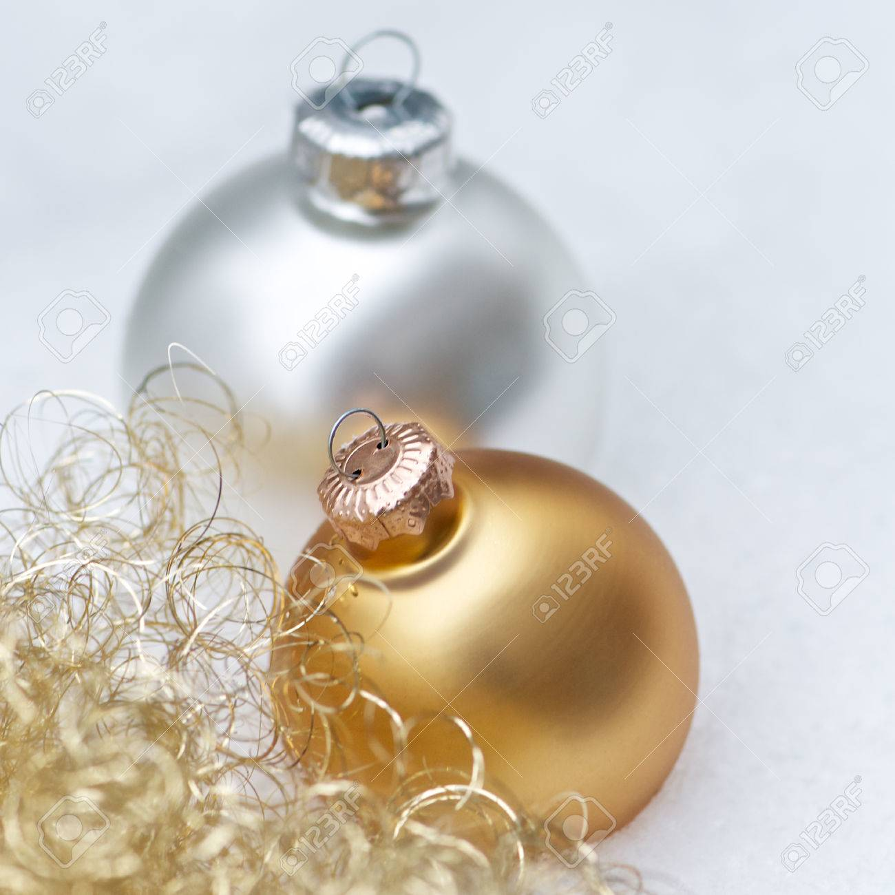 Golden And Silver Christmas Tree Balls And Angelhair On White