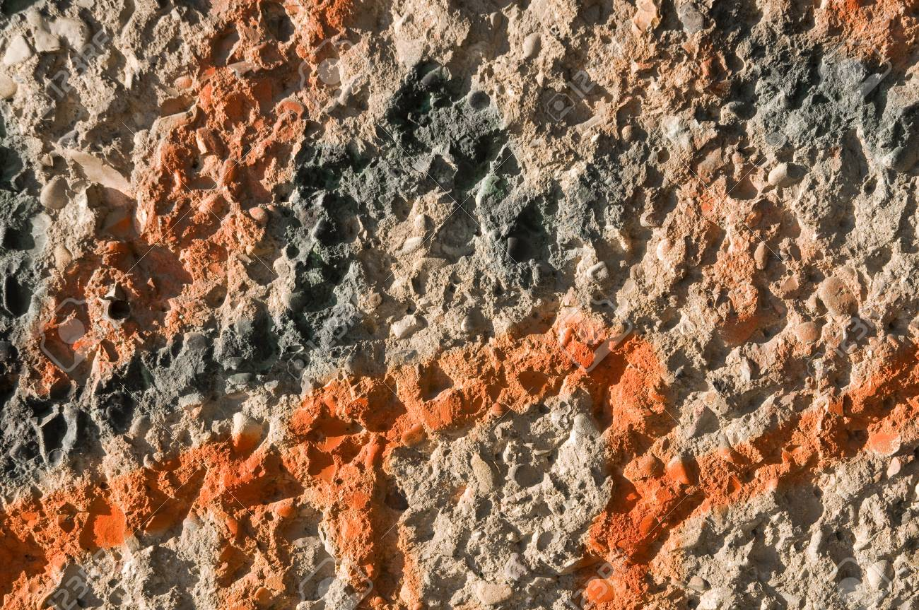 Concrete Wall With Grey And Orange Spray Paint In Closeup Landscape