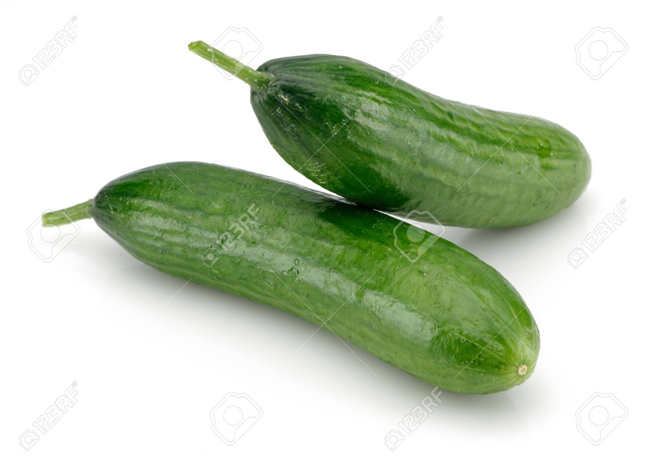 Fresh cucumbers isolated on white background - 124006161