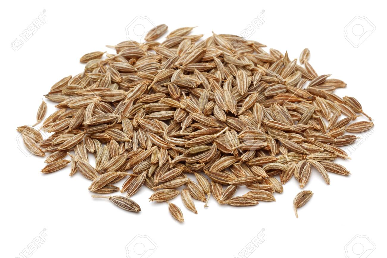 Heap of Cumin seeds isolated on white background - 128991941
