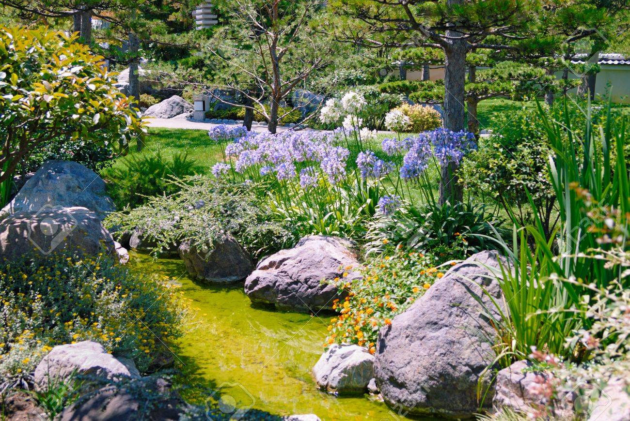 beautiful garden with stream stock photo picture and royalty free