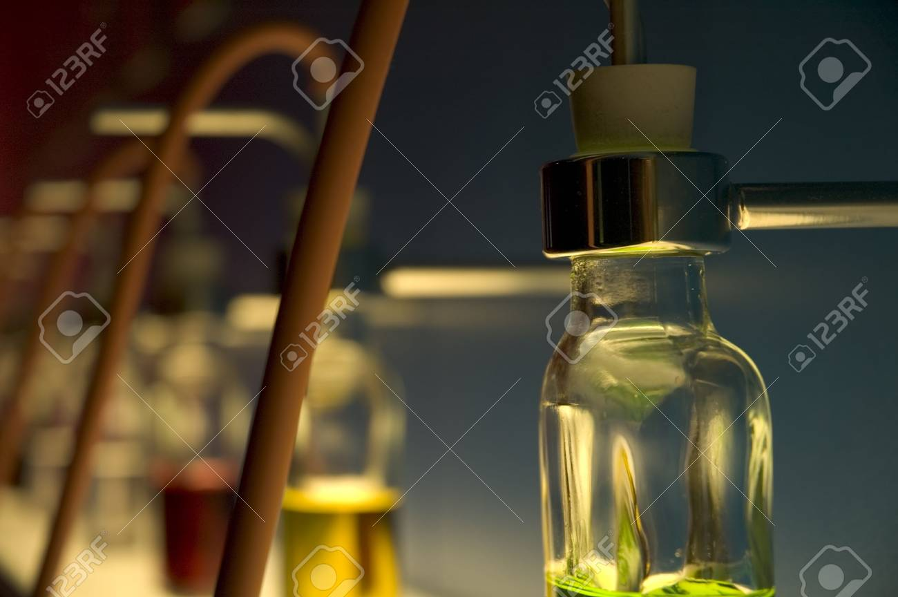 Many bottles with different colors in a row. Stock Photo - 1746385