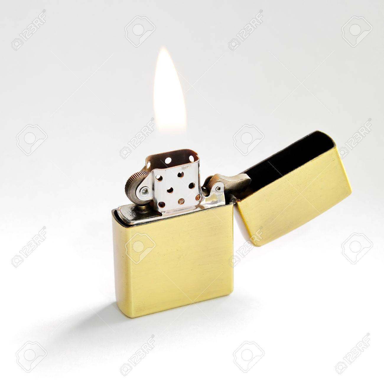 Closed Up Zippo Lighter With Flame Isolated On White Background Stock Photo
