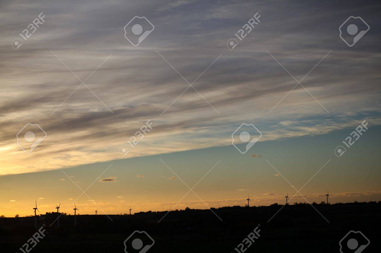 Dusk, danish landscape with many windturbines in silhouette Stock Photo - 16171223