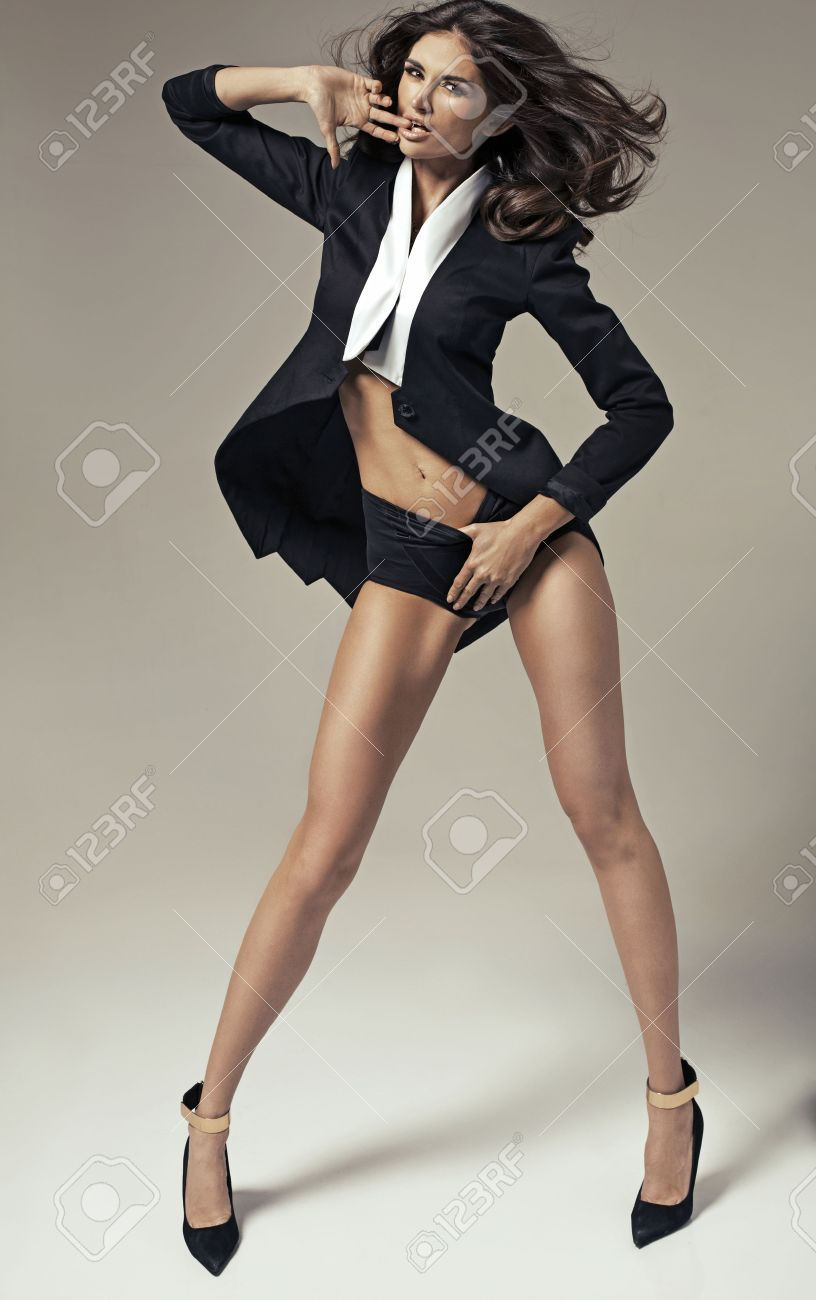Smart adult woman in the pose of temptation Stock Photo - 30526009
