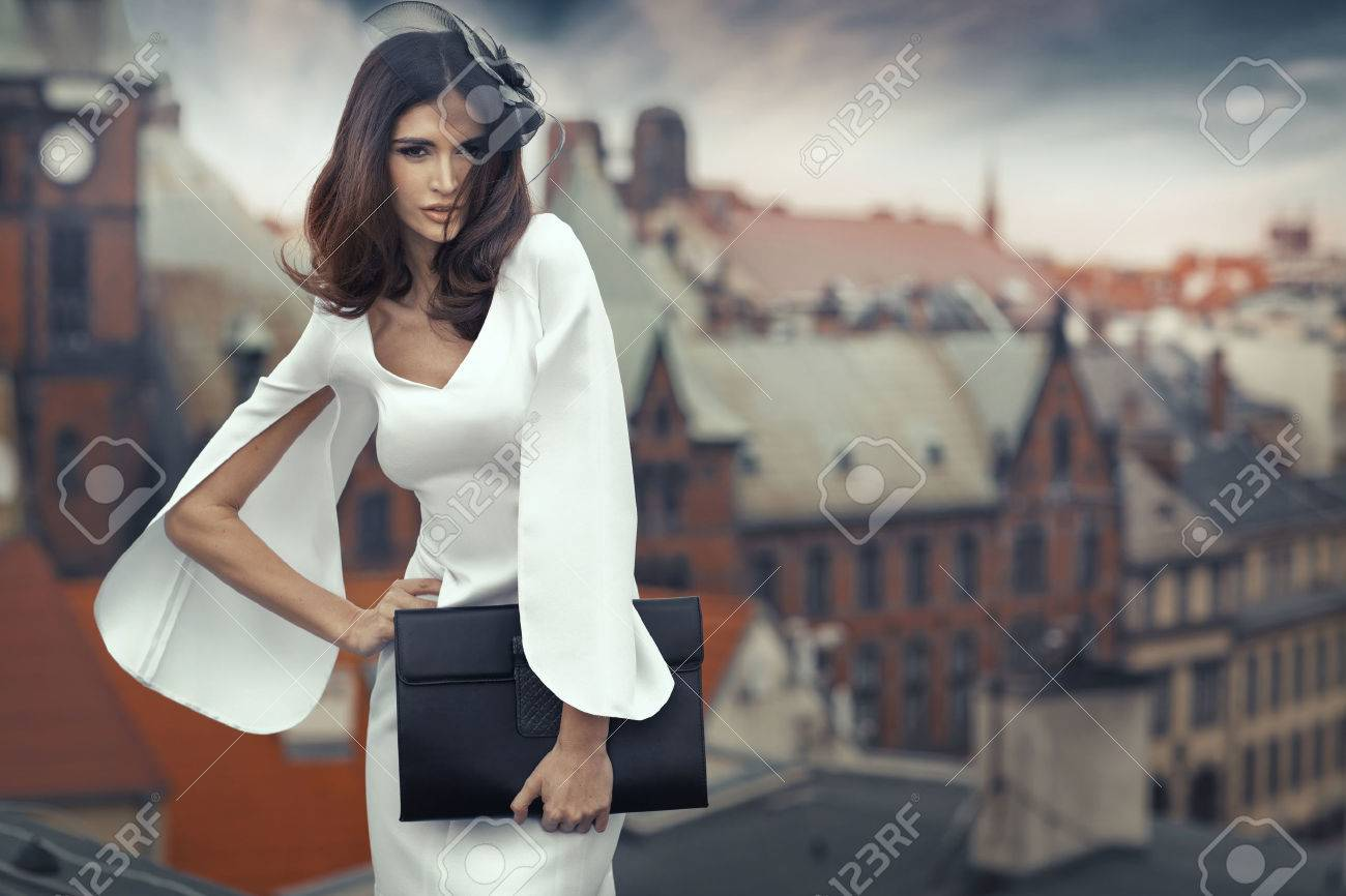 Smart brunette woman with the panorama city in the background - 30526062