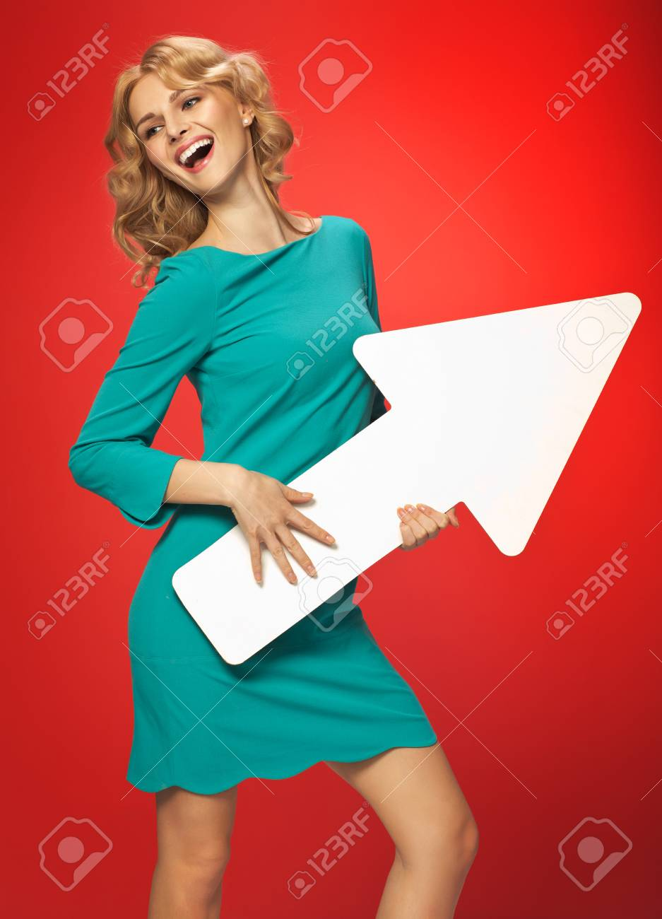 Blond lady with the conceptual white arrow Stock Photo - 30526093