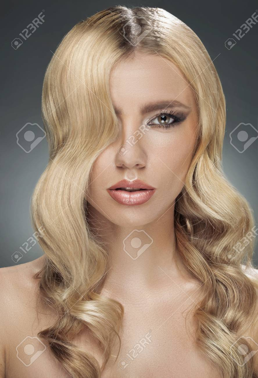 Portrait of the blond woman with huge lips Stock Photo - 30525150