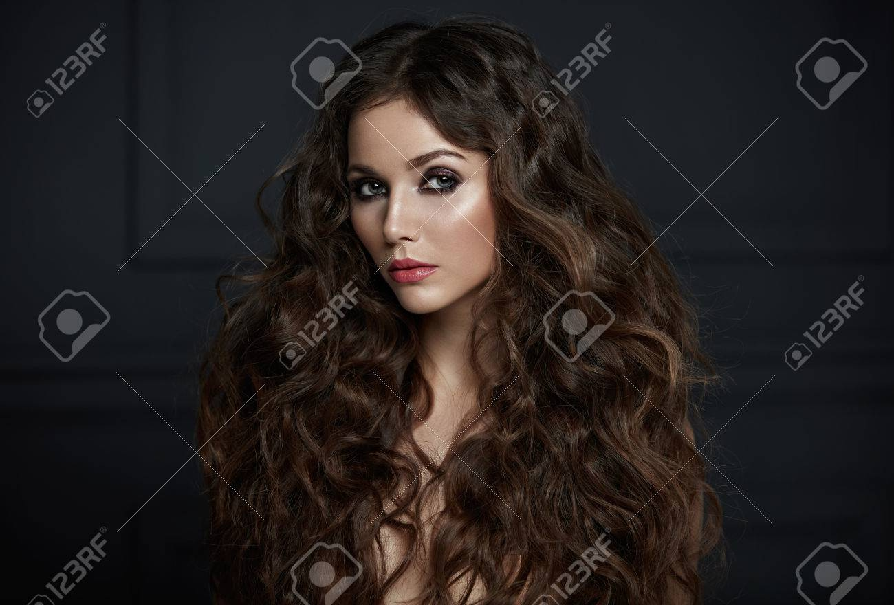 Portrait of an adorable woman with lots of fluffy curls - 74881752