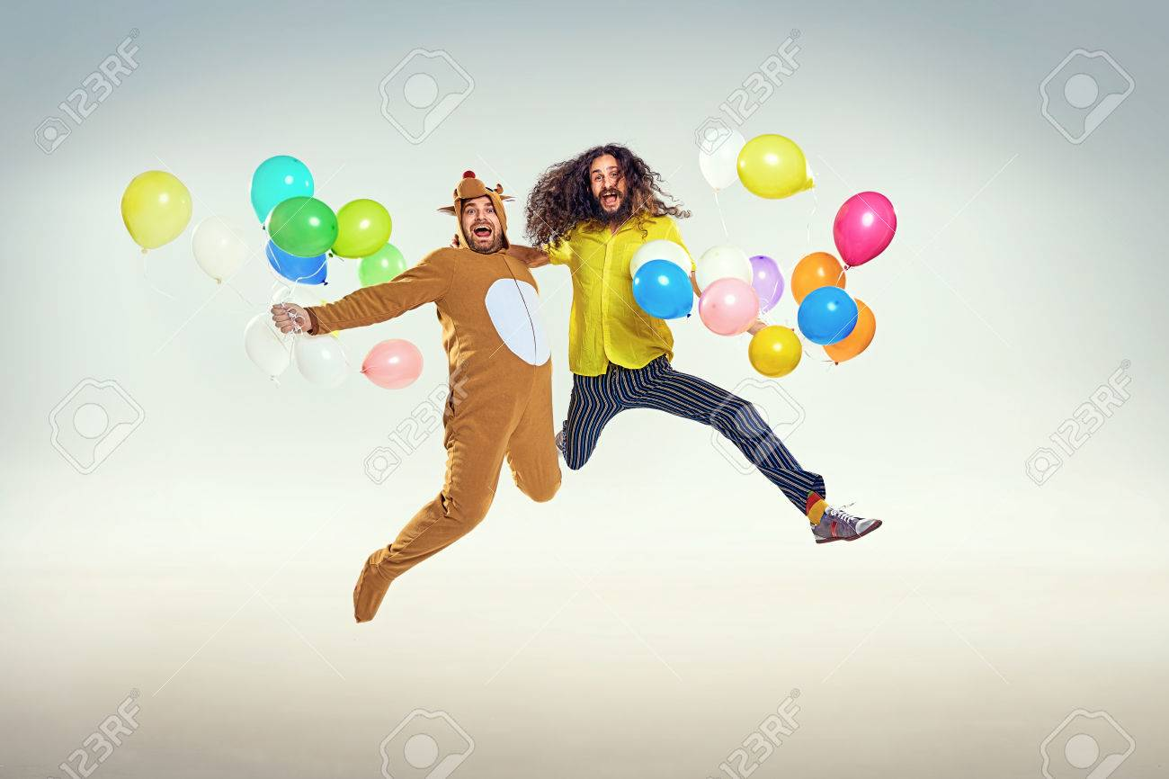 Picture presenting two funny men jumping and holding balloons - 85169794