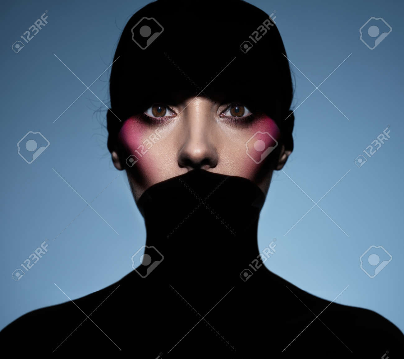 Closeup portrait of brunette woman hiding in shade - 166589094