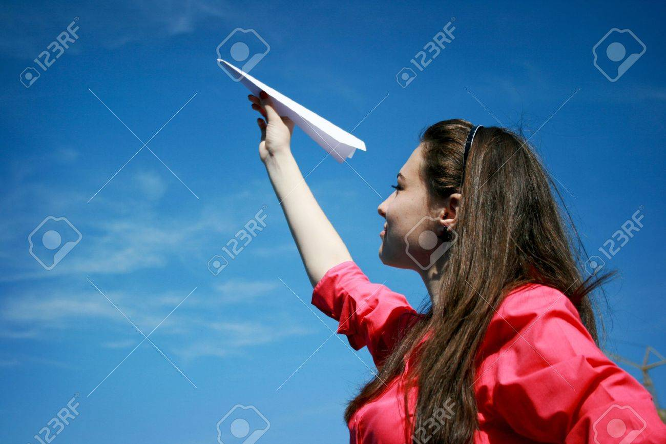 Young caucasian girl with paper plane in the hand Stock Photo - 10336691