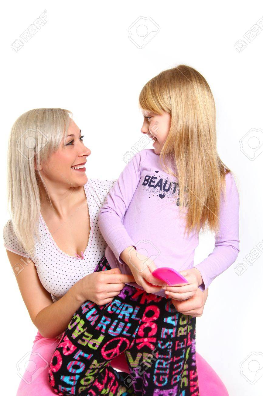 Happy mother and daughter with a comb looking at each other Stock Photo - 18034564