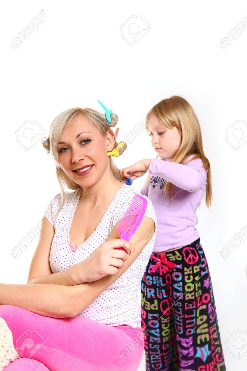 Little girl styling her mother's hair Stock Photo - 18034590