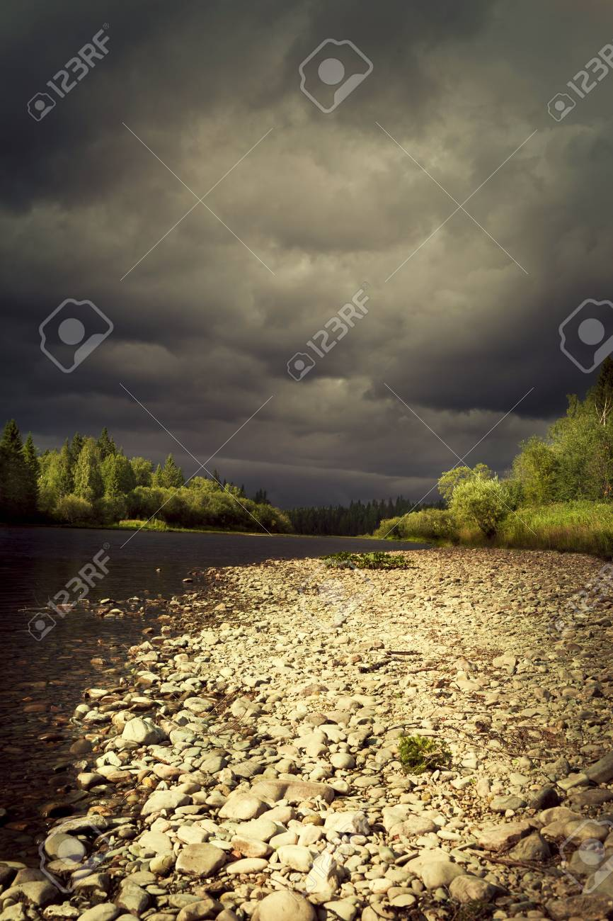 Photo storm clouds over the river Stock Photo - 22141522