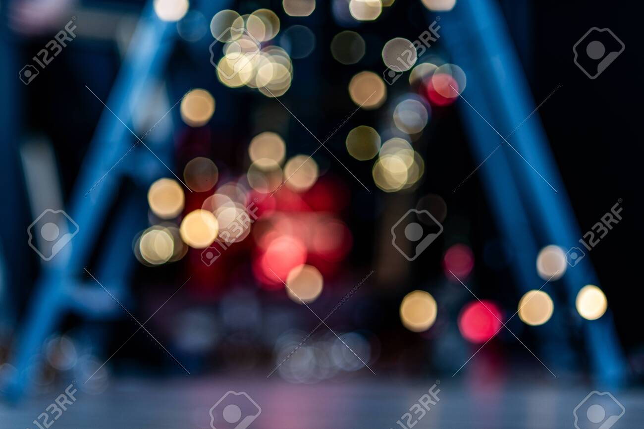 Blurry, abstract background of Christmas lights in a pre-holiday city. - 152896069