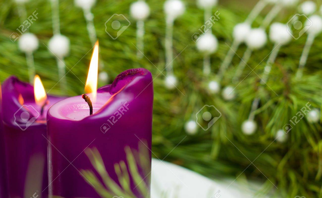 A burning Christmas candles and green spruce branches Stock Photo - 11731791