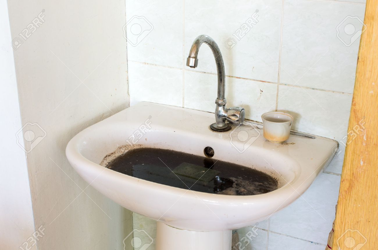 Bathroom Sinks Clogged old dirty ant clogged sink in bathroom stock photo, picture and