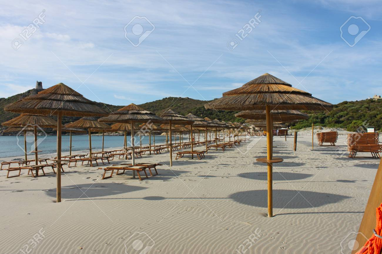 Rows Of Umbrellas And Sunbeds On A Beach In Sardinia