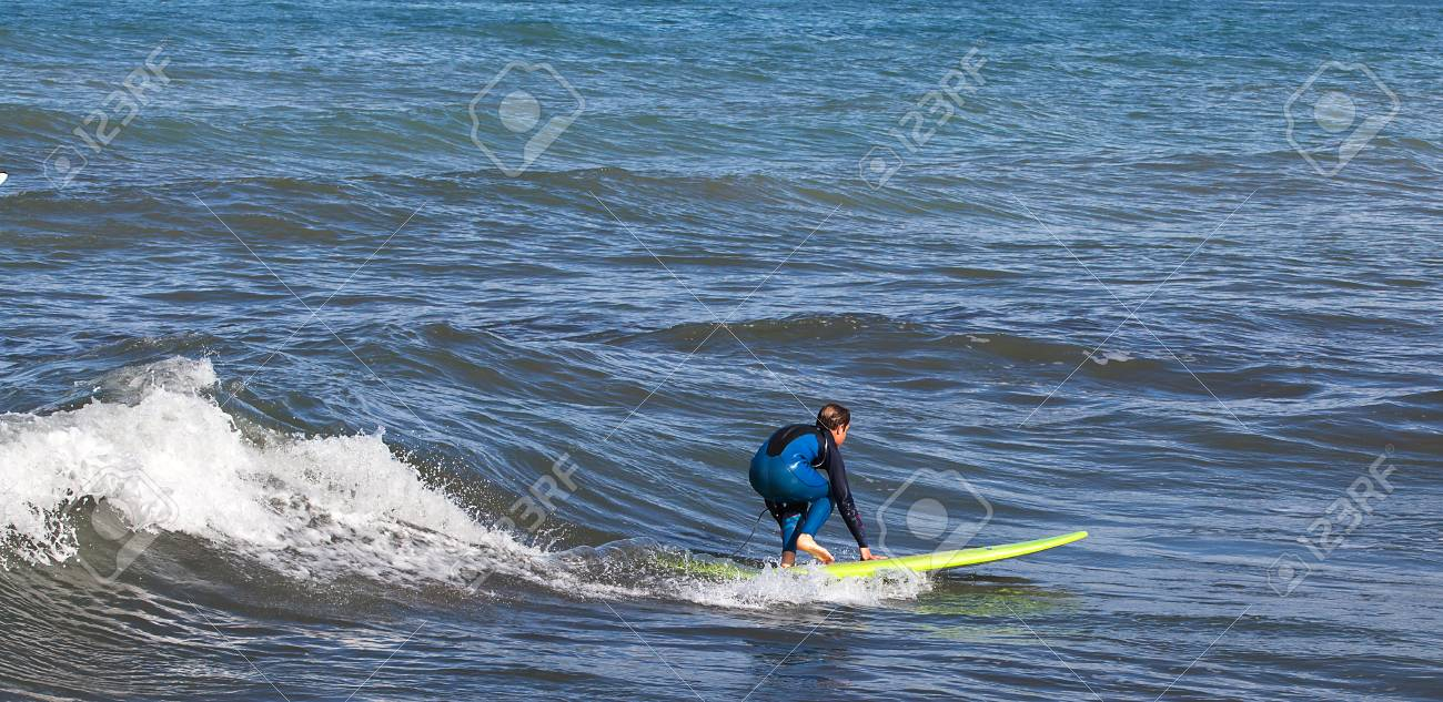 One surfer in the water waiting for the wave. - 81018392