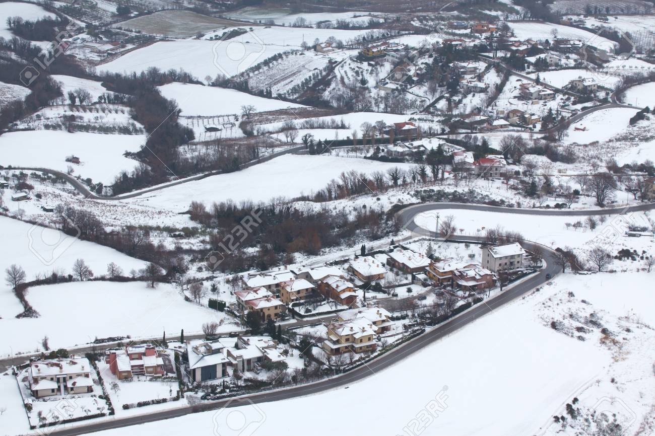 The village and fields in the snow. Beautiful view. - 84873521