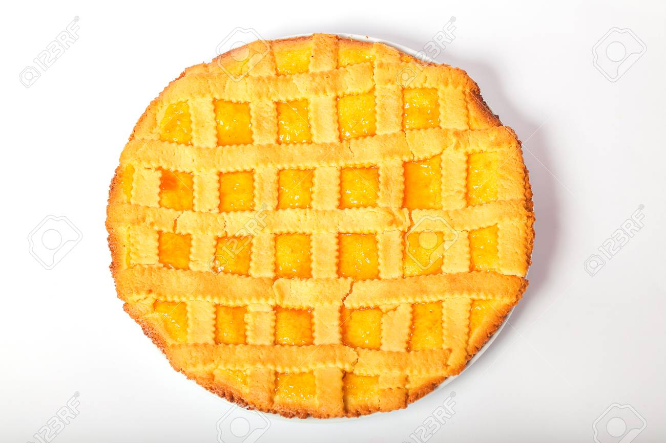 Crostata with apricot jam. Isolated white background. - 86039885
