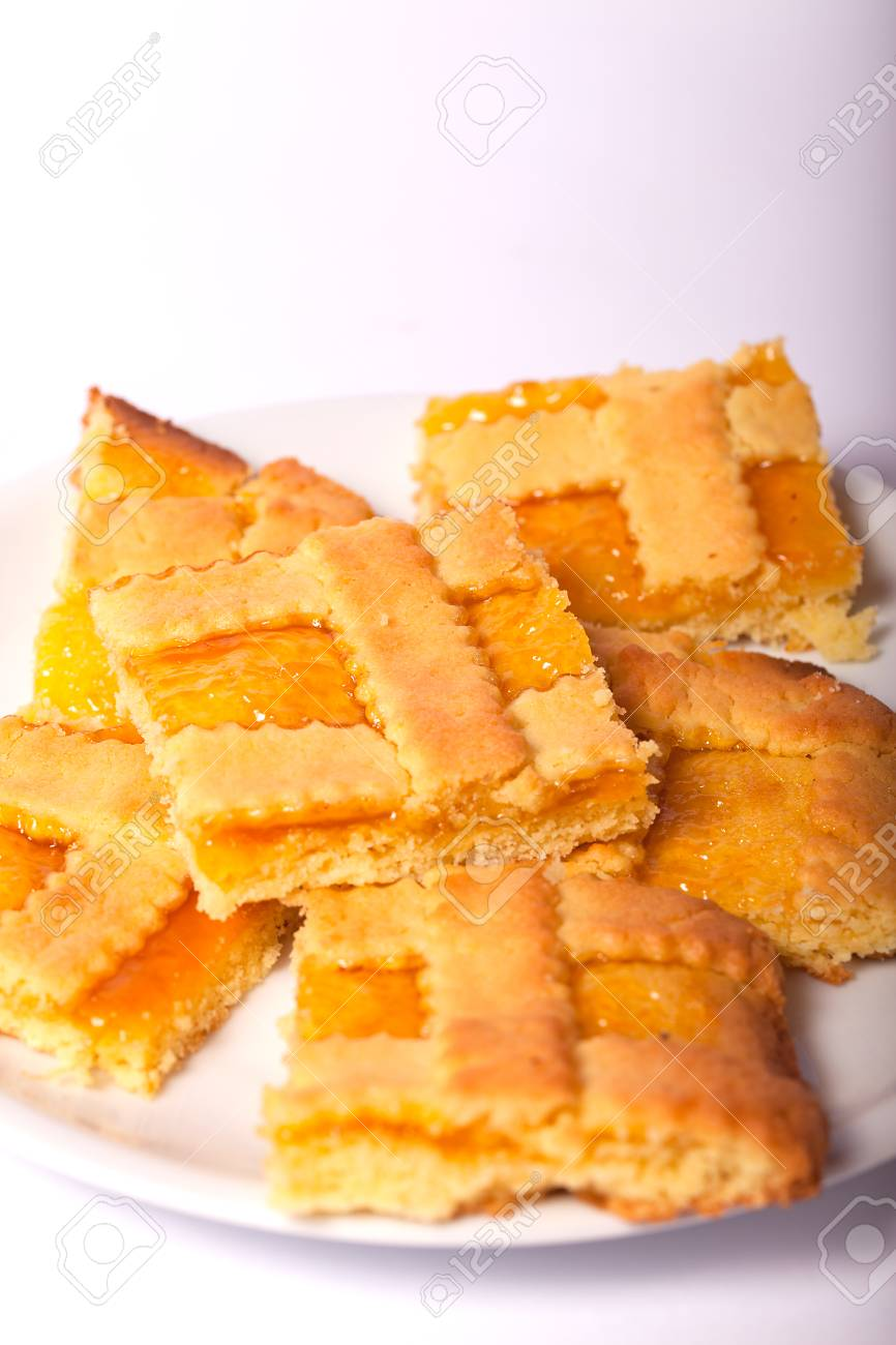 Crostata with apricot jam. Isolated white background. - 87094792