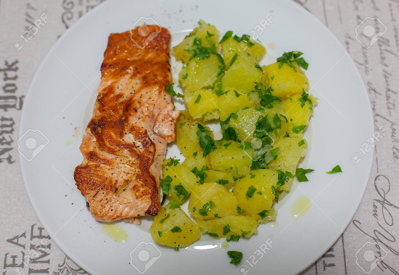 Salmon with boiled potatoes and parsley. - 87920998