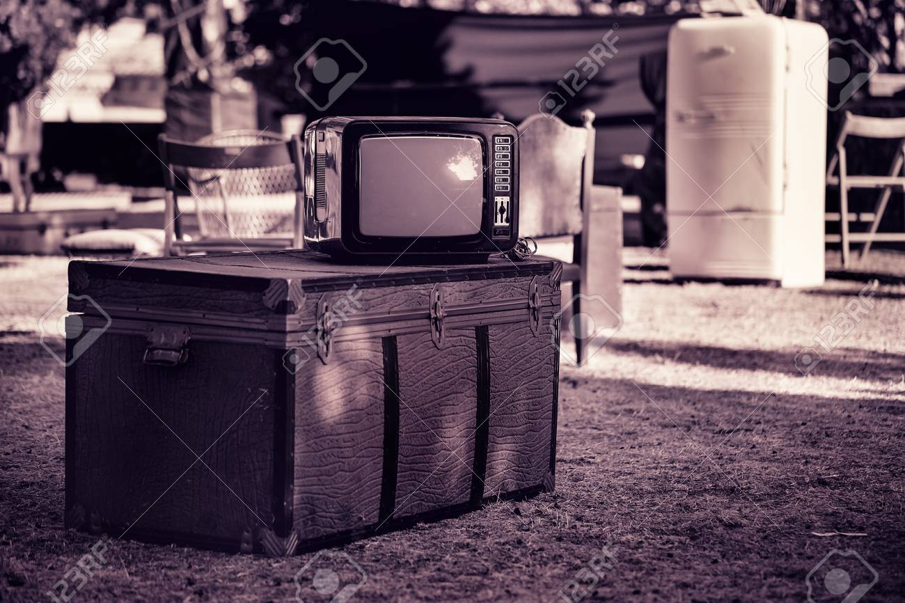 Old TV, chest and various furniture on the street. - 88647445