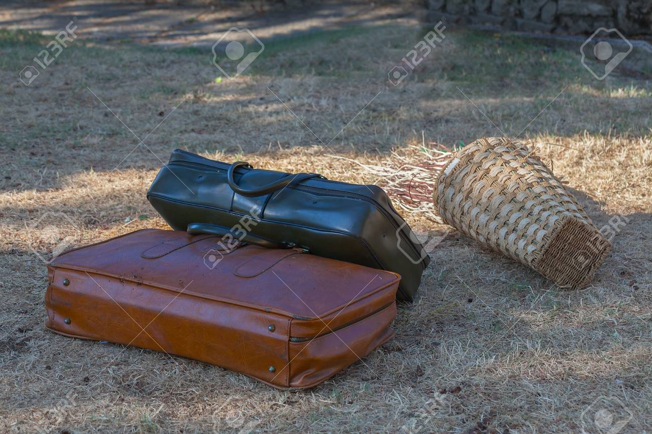 Two old suitcases on the grass close-up. - 89034738