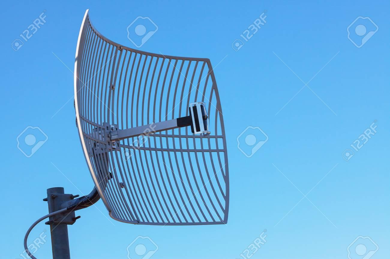 Antenna TV on blue sky background. Technological network. - 89474680