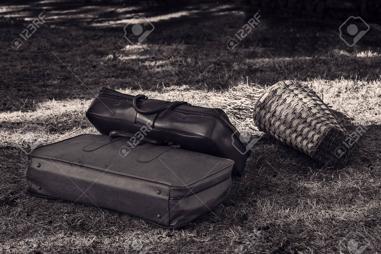 Two old suitcases on the grass close-up. - 93472821