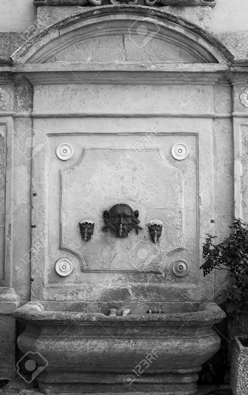 Antique street drinking fountain close-up. - 98423707
