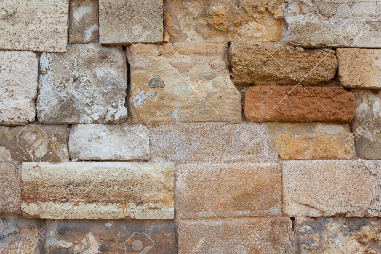 Ancient wall close-up. Background. Old stone wall. - 105827976