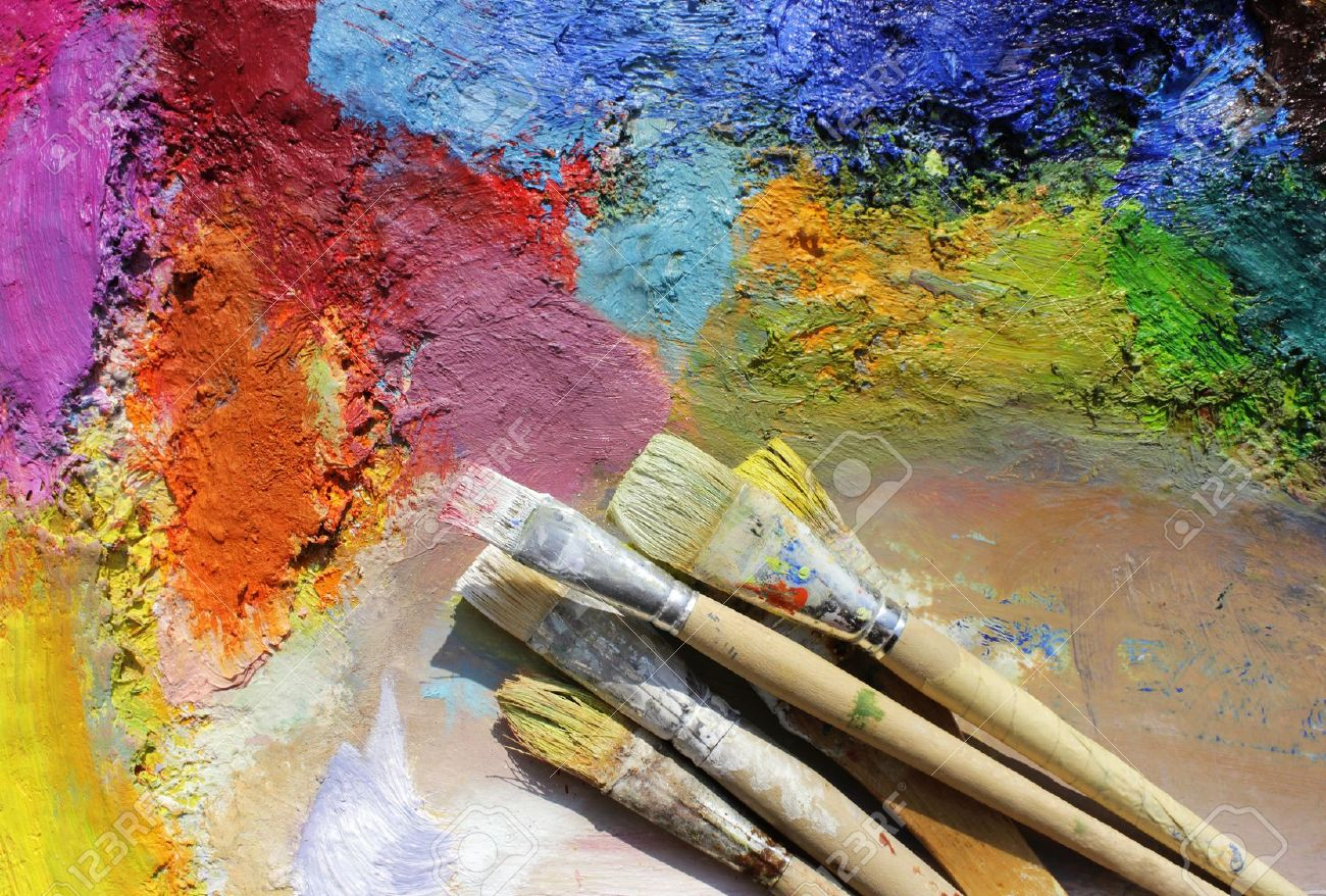 oil paints and paint brushes on a palette Stock Photo - 9373300