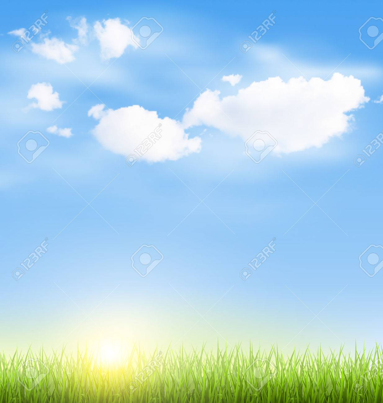 green grass lawn with clouds and sun on blue sky royalty free