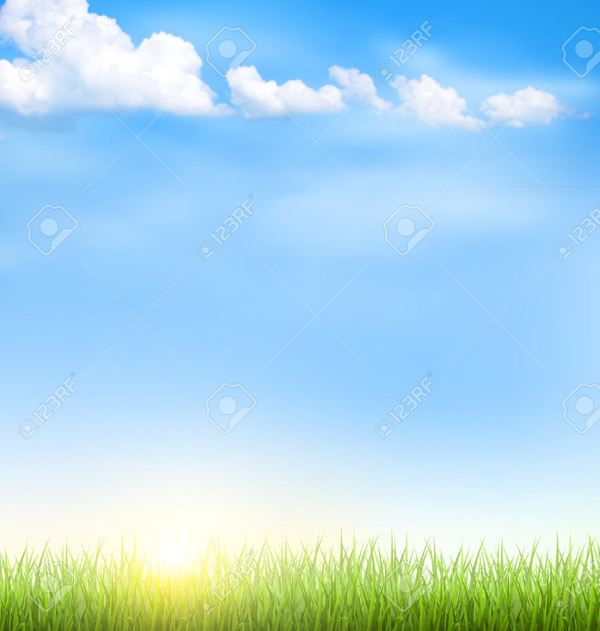 Green grass lawn with clouds and sun on blue sky - 41732313